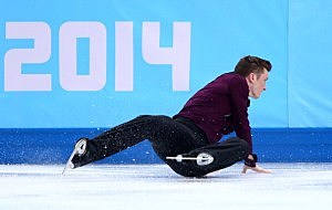 Jeremy Abbott of the United States falls while competing in the Figure Skating Men's Short Program during the Sochi 2014 Winter Olympics