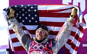 Sage Kotsenburg of the United States celebrates winning gold after his second run during the Snowboard Men's Slopestyle Final