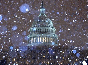 Snow falls in front of the U.S. Capitol building