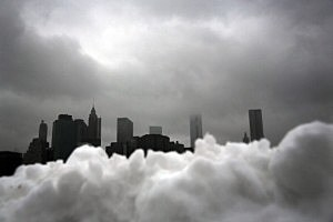 Part of the lower Manhattan skyline seen behind a pile of snow