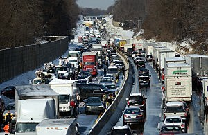 Rescue and fire personnel assist on the scene of a 100 car chain reaction pileup accident on the Pennsylvania Turnpike