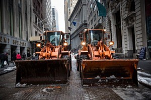 Backhoes are seen after clearing Wall Street of snow