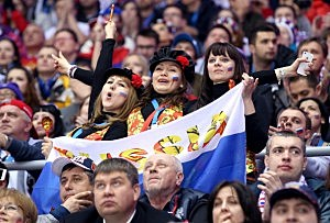Fans celebrate during the Men's Ice Hockey Preliminary Round Group A game between Russia and the United States