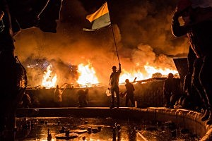 Anti-government protesters guard the perimeter of Independence Square, known as Maidan  in Kiev, Ukraine