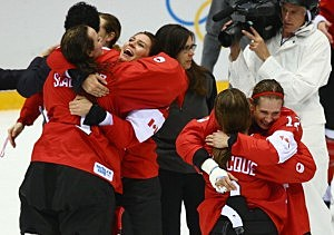 Canada celebrates after Marie-Philip Poulin #29 scored the game-winning goal against the United States in overtime during the Ice Hockey Women's Gold Medal Game