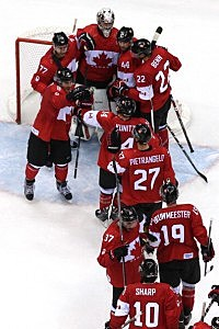 Canada celebrates after defeating the United States 1-0