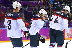 Cam Fowler #3, Patrick Kane #88 and John Carlson #4 of the United States react after losing 1-0 to Canada