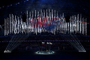 The national flag of South Korea (R) is raised next to the flags of Russia (L) and Greece during the 2014 Sochi Winter Olympics Closing Ceremony at Fisht Olympic Stadium