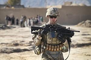 U.S. Army's 4th squadron 2d Cavalry Regiment patrols through a village near Kandahar, Afghanistan.