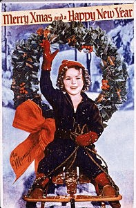 Christmas card or promotional portrait of American child actress Shirley Temple, who rides on a sled and waves, 1930s. (
