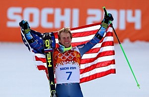 Gold medalist Ted Ligety of the United States celebrates during the flower ceremony for the the Alpine Skiing Men's Giant Slalom