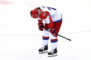 Anton Belov #77 of Russia reacts after Finland defeated Russia 3-1 during the Men's Ice Hockey Quarterfinal Playoff