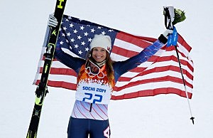 Bronze medalist Julia Mancuso of the United States celebrates during the flower ceremony for the Alpine Skiing Women's Super Combined