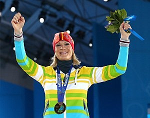 Gold medalist Maria Hoefl-Riesch of Germany celebrates during the medal ceremony for the Alpine Skiing Women's Super Combined