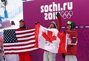 (L-R) Silver medalist Devin Logan of the United States, gold medalist Dara Howell of Canada and bronze Kim Lamarre of Canada celebrate after the Freestyle Skiing Women's Ski Slopestyle Finals