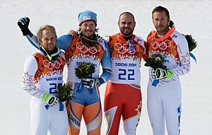 (L-R) Silver medalist Andrew Weibrecht of the United States, gold medalist Kjetil Jansrud of Norway and bronze medalists Jan Hudec of Canada and Bode Miller of the United States celebrate on the podium during the flower ceremony for the Alpine Skiing Men's Super-G