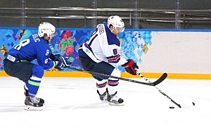 Phil Kessel #81 of the United States handles the puck against Ziga Jeglic #8 of Slovenia
