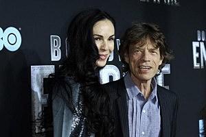 Designer L'Wren Scott and singer Mick Jagger