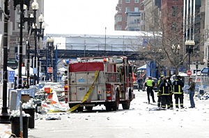 Firefighters take postion on Boyltson Street near the finish line after two bombs exploded during the 117th Boston Marathon on April 15, 2013