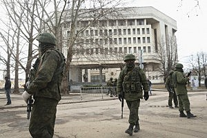 Heavily-armed soldiers without identifying insignia guard the Crimean parliament building shortly after taking up positions there on March 1, 2014 in Simferopol, Ukraine.