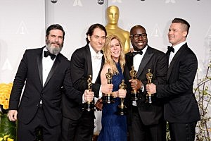 "(L-R) Producers Anthony Katagas, Jeremy Kleiner, Dede Gardner, Brad Pitt and director Steve McQueen, winners of Best Picture for ""12 Years a Slave"", pose in the press room during the Oscars"