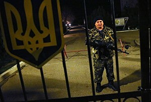 A Ukrainian soldier at the Belbek military base stands on alert anticipating a possible Russian attack in Lubimovka, Ukraine