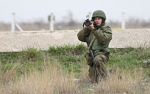 A soldier under Russian command aims a rocket propelled grenade launcher at a group of over 100 hundred unarmed Ukrainian troops who appeared at the Belbek airbase, which the Russian troops are occcupying, in Crimea in Lubimovka, Ukraine