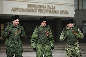 Cossacks stand guard at the entrance to the Crimean Parliament building in Simferopol, Ukraine.