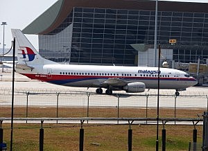 Malaysia Airline passenger jets are shown parked on the tarmac at the Kuala Lumpur International Airport
