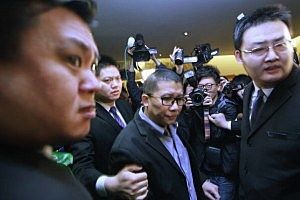 Ignatius Ong from Malaysia Airline answers media questions at Lido Hotel on in Beijing, China