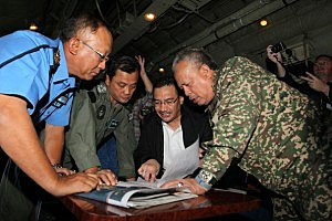 In this handout provided by the Angkatan Tentera Malaysia, Malaysian Royal Navy (TLDM) commander Tan Sri Abdul Aziz Jaafar (left), Lieutenant General Dato' Sri Ackbal bin Hj Abdul Samad (2nd left), Malaysian Defence Minister, Minister of Defence & (Acting) Minister of Transport Dato' Seri Hishammuddin Hussein (2nd right), and Malaysian Defence Forces chief Tan Sri Zulkifeli Mohd Zin discuss their strategy during a search and rescue mission flight