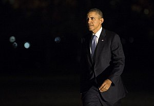 President Barack Obama returns to the White House after a day trip to New York