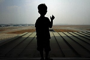 A boy waits for his family members arrival at Kuala Lumpur International Airport