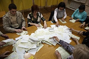 Election staff begin the count at a polling station after a day of voting in Bachchisaray, Ukraine.