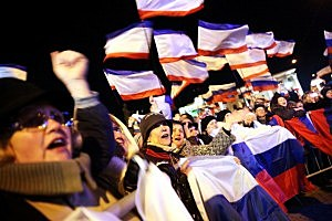 People in Lenin Square attend a pro Russian rally after a day of voting  in Simferopol, Ukraine.