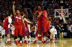 Devin Oliver #5 of the Dayton Flyers reacts after defeating the Syracuse Orange 55-53 in the third round of the 2014 NCAA Men's Basketball Tournament