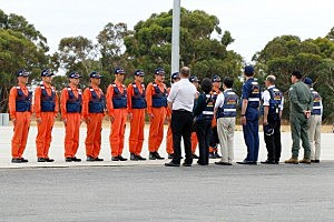 Members of the Japan Coast Guard are greeted by officials at the Pearce Airforce base in Australia
