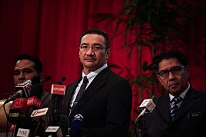 Malaysia's Minister of Defence and acting Minister of Transport Hishammuddin Hussein (C)