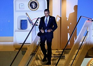 President Barack Obama walks down the stairs from Air Force One after arriving at Fiumicino Airport in Rome