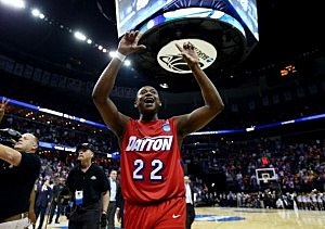 Kendall Pollard #22 of the Dayton Flyers celebrates after defeating the Stanford Cardinal 82-72