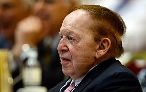 Las Vegas Sands Corp. CEO Sheldon Adelson listens to New Jersey Gov. Chris Christie speak