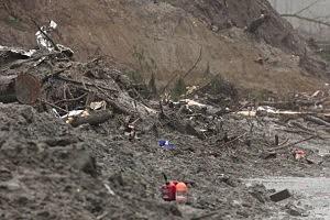 Chainsaw equipment sits atop mudslide debris at the Oso, Washington  mudslide site