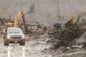 Crews work at the Oso mudslide site in Oso, Washington