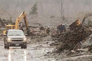 Crews work at the Oso mudslide site in Oso, Washington