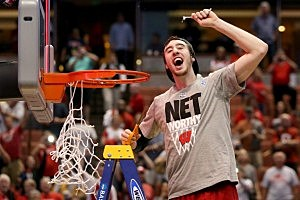 Frank Kaminsky #44 of the Wisconsin Badgers celebrates after he cuts down the net after defeating the Arizona Wildcats 64-63 in overtime
