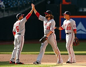 Anthony Rendon #6 of the Washington Nationals celebrates the win with teammates Jayson Werth #28 and Ian Desmond #20 during Opening Day