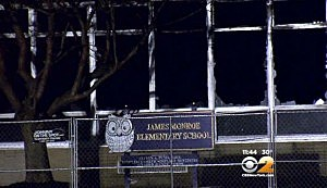 Broken windows at the burned out James Monnoe Elementary School in Edison