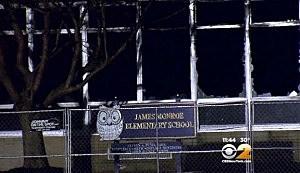 Broken windows at the burned out James Monnoe Elementary School in Edison