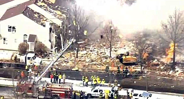 Aerial view of firefighters at the scene of a Ewing home explosion