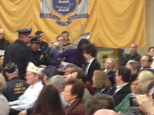 Police escorting a heckler from Governor Christie's town hall meeting in Mt. Laurel